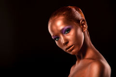 Gilt. Golden Woman's Face Closeup. Futuristic Gilded Make-up. Painted Skin bronze. Stock Images