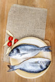 Gilt-head bream fish on wooden background. Mediterranean tavern, delicious meal. Write down here your best recipe for fish plate Royalty Free Stock Image