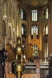 Gilt lectern in Peterborough Cathedral. Gilt lectern inside Peterborough Cathedral Cathedral Church of St. Peter, St. Paul and St. Andrew, Peterborough stock image
