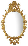 Gilt Mirror. Antique Gold lavish gilt mirror on white background Royalty Free Stock Photo