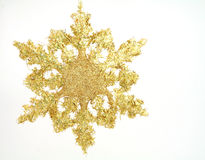 Gilt snowflake. Fluffy gilt snowflake for decoration on christmas tree Stock Images