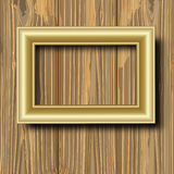 Gilted frame on wood Stock Photo