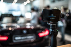 Gimbal camera in action. With sport car in background Royalty Free Stock Photos