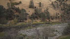 Gimbal down shot of merced river in daytime. Wide photo Royalty Free Stock Photo