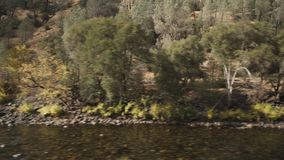 Gimbal down shot of merced river in daytime. Wide photo Stock Photos