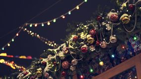 Fir artificial branch with christmas beads and balls on the house roof. Gimbal handheld shot of fir artificial branch with christmas beads and balls on the roof stock video footage