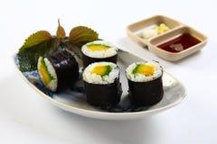 Gimbap or Futomaki on a white background Stock Photos