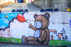 Street art on a brick wall in Gimhae. Gimhae, South Korea - March 10, 2018 : Street art on a brick wall in Gimhae Royalty Free Stock Image