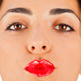Gimme a Kiss. Beautiful brunette woman with red lipstick on sending kisses Stock Image