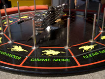 Gimme More. Spinning real at a carnival with pictures of horse racing and the words Gimme More on it royalty free stock image