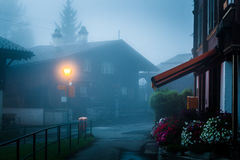 Gimmelwald Village, Switzerland. View of the Swiss moountain village of Gimmelwald on a foggy morning Stock Images