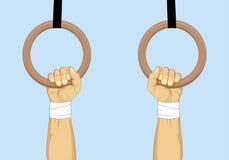 gimnástico Manos en los anillos de la gimnasia Fotos de archivo libres de regalías