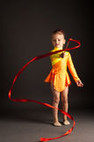 Gimnasia de la niña con la cinta Imágenes de archivo libres de regalías