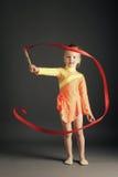 Gimnasia de la niña con la cinta Foto de archivo libre de regalías