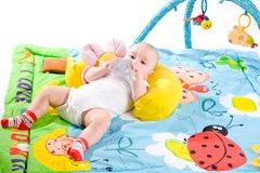 Gimnasia del bebé aislada Imagenes de archivo
