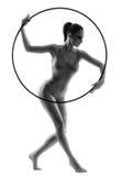 Gimnasta de la mujer con el aro del hula Foto de archivo libre de regalías