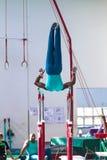 Gimnastyczek konkurowania Męscy Rutynowi bary Obraz Stock