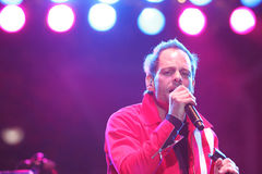 Gin Blossoms. TEMPE, AZ - DEC 31: Robin Wilson, lead singer of the Gin Blossoms performs for fans celebrating New Years Eve at the Fiesta Bowl Block Party, Mill Royalty Free Stock Images