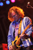 Gin Blossoms. TEMPE, AZ - DEC 31: Scott Johnson, guitarist for the Gin Blossoms performs for fans celebrating New Years Eve at the Fiesta Bowl Block Party, Mill stock photos