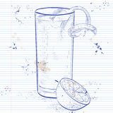 Gin Fizz cocktail on a notebook page. Gin Fizz cocktail consisting of Lime, lemon, sugar syrup, cream, egg, water of orange blossom, vanilla extract, Soda Royalty Free Stock Images