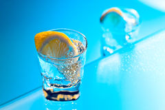 Gin with lemon on a glass table Royalty Free Stock Photography