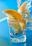 Gin with lemon on a glass table Royalty Free Stock Images