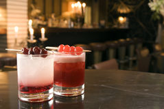 Gin and Sherry. Two coktails with Gin and Sherry, decoradet with cherries Stock Photo