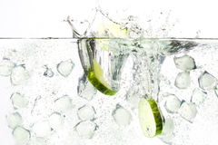 Gin tonic. Fresh image of a beverage gin tonic with cucumber and ice cubes royalty free stock image