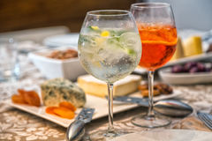 Gin Tonic and Aperol Spritz. With antipasto Royalty Free Stock Photography