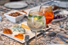 Gin Tonic and Aperol Spritz. With antipasto background Royalty Free Stock Image