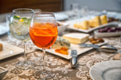 Gin Tonic and Aperol Spritz. With antipasto background Stock Photography
