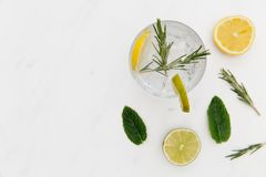 Gin tonic cocktail drink with green lime white background. Gin tonic cocktail drink with green lime on white background stock photos