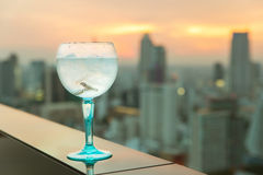 Gin tonic cocktail on table in rooftop bar Stock Images