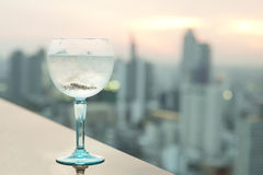 Gin tonic cocktail on table in rooftop bar Stock Photography