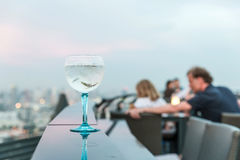 Gin tonic cocktail on table in rooftop bar Royalty Free Stock Images