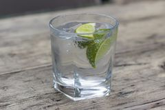 Gin and tonic. With slice of lime in a glass royalty free stock image