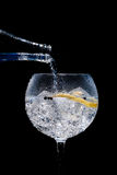 Gin tonic. Glass of gin and tonic on black background royalty free stock images
