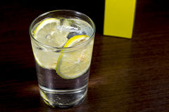 Gin and tonic glass seen from above, over dark wood table Stock Photography