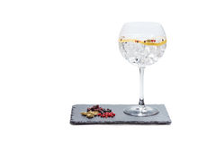 Gin tonic. Glass of gin and tonic on slate plate with white background stock image
