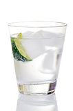 Gin And Tonic On Ice With Lime Wedge Royalty Free Stock Photos