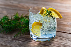 Gin and tonic. With lemon and ice on wooden table royalty free stock images