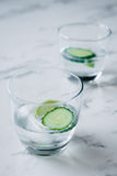 Gin and tonic with lime and cucumber on a marble background Stock Image