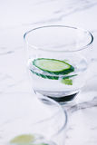 Gin and tonic with lime and cucumber on a marble background Stock Photo