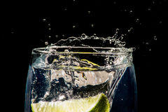 Gin&Tonic with Lime. Lime dropping into a gin and tonic stock photo