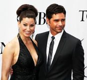 Gina Gershon and John Stamos royalty free stock photos
