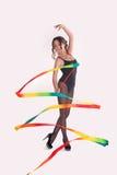 A ginasta com uma fita Fotografia de Stock
