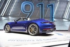 Ginevra, Svizzera - 5 marzo 2019: L'automobile del cabriolet di Porsche 911 Carrera 4s ha montrato all'ottantanovesimo salone del fotografia stock libera da diritti