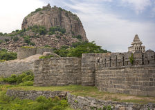 Gingee fort dominates the hill with ramparts. royalty free stock image