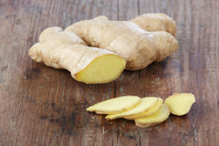 Ginger. Root on a wooden table Stock Photo