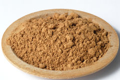 Ginger. A plate of ginger powder royalty free stock photography